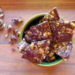 Looking for an easy chocolate bark recipe? Try this combo of pistachio, almond, sea salt - although the possibilities are endless!